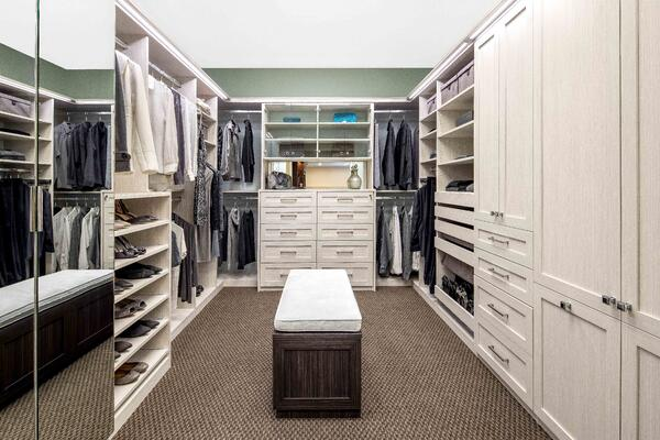 Deluxe walk-in closet at Valet Custom Cabinets & Closets in Campbell, CA