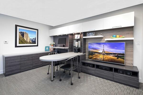 Home office with Media Center by Valet Custom Cabinets & Closets