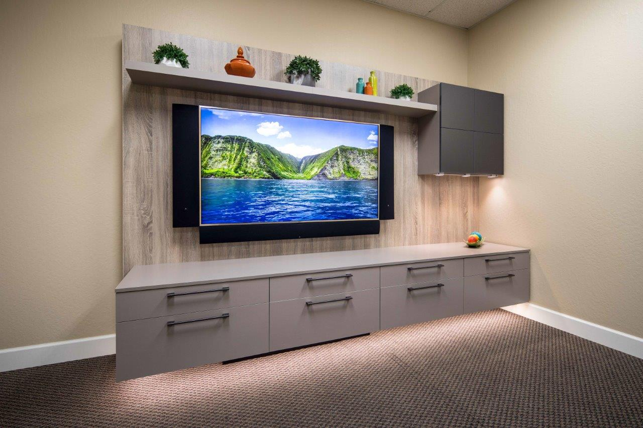Home entertainment center by Valet Custom Cabinets and Closets and The Integrated Lifestyle