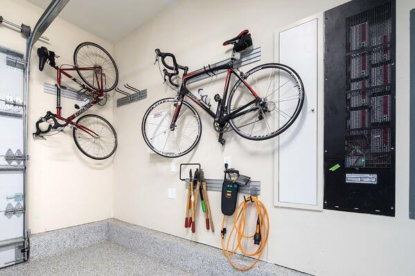 Custom Garage by Valet Custom Cabinets & Closets Omni-Track and Accessories