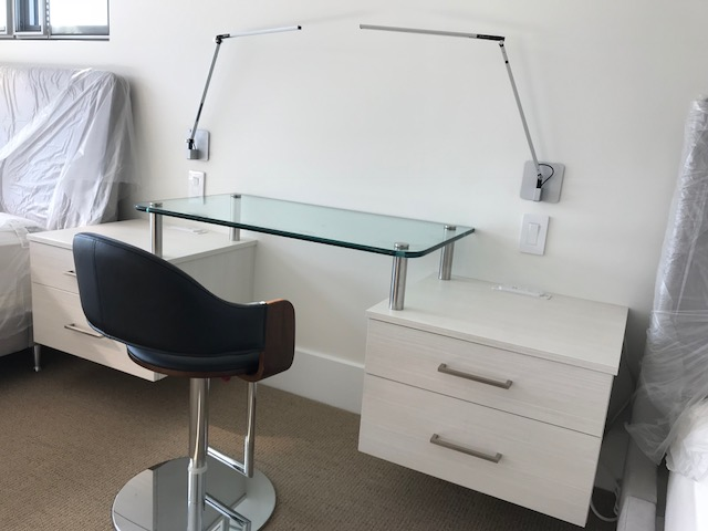 Floating side tables and glass desk from Valet Custom Cabinets & Closets