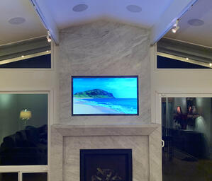 Home entertainment center by  The Integrated Lifestyle