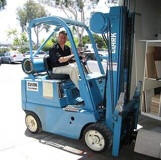 Larry on a forklift in the warehouse